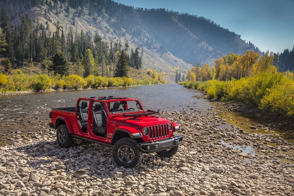 Jeep Wrangler - A Compact SUV on the shore of the river.